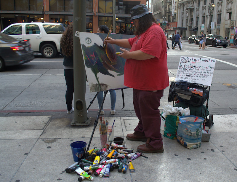 A Homeless Artist Paints Freestyle During The Downtown Art Walk