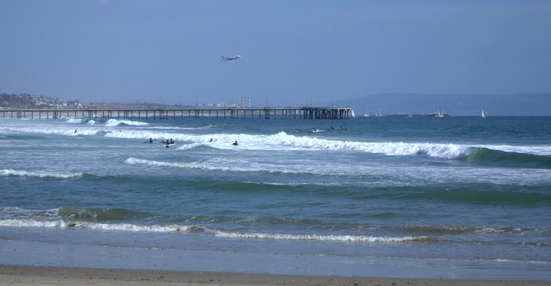 The Venice Beach Boardwalk and a Plane Taking off from LAX