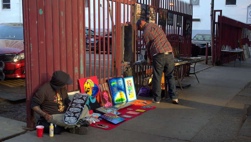 Artist Painting on a Skateboard During The Downtown Art Walk