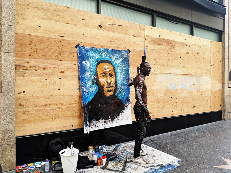 Protester Paints George Flyod during Hollywood Protest.