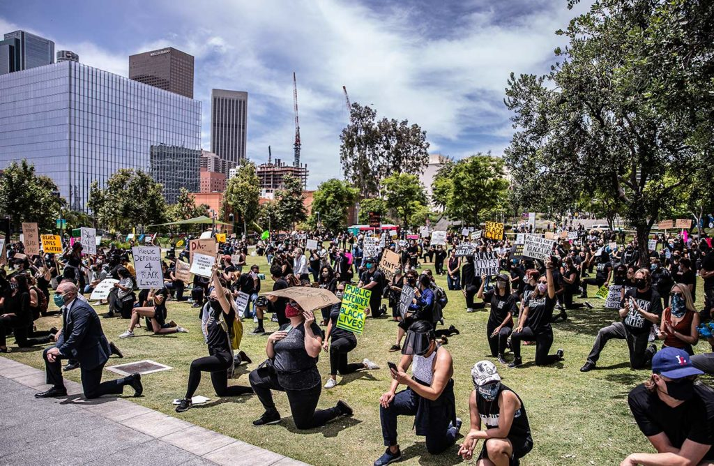 Protesters take a knee in front of City Hall at Grand Park for Black Lives Matter