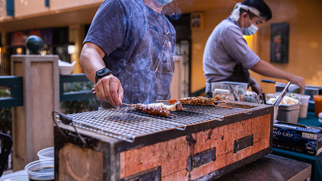 Skewers cooking on a Konro grill at Steep After Dark
